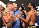 LAS VEGAS, NV - APRIL 20:   (L-R) Opponents Robert Whittaker of New Zealand and Rafael Natal of Brazil face off during the UFC 197 weigh-in at the MGM Grand Garden Arena on April 20, 2016 in Las Vegas, Nevada. (Photo by Josh Hedges/Zuffa LLC/Zuffa LLC via Getty Images)