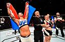 ROTTERDAM, NETHERLANDS - MAY 08:  (L-R) Germaine de Randamie celebrates her victory over Anna Elmose in their women's bantamweight bout during the UFC Fight Night event at Ahoy Rotterdam on May 8, 2016 in Rotterdam, Netherlands. (Photo by Josh Hedges/Zuffa LLC/Zuffa LLC via Getty Images)