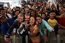 "RIO DE JANEIRO, BRAZIL - MAY 11: Catchweight Cris ""Cyborg"" Justino of Brazil takes photos with fans during an open training session at Arena da Baixada stadium on May 11, 2016 in Curitiba, Brazil. (Photo by Buda Mendes/Zuffa LLC/Zuffa LLC via Getty Images) ***Local Caption*** Cris ""Cyborg"" Justino"