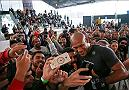 "RIO DE JANEIRO, BRAZIL - MAY 11: Middleweight contender Ronaldo 'Jacar��"" Souza of Brazil takes photos with fans during an open training session at Arena da Baixada stadium on May 11, 2016 in Curitiba, Brazil. (Photo by Buda Mendes/Zuffa LLC/Zuffa LLC via Getty Images) ***Local Caption*** Ronaldo Jacar�� Souza"