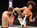INGLEWOOD, CA - JUNE 04: Alex Caceres kicks Cole Miller in their featherweight bout during the UFC 199 event at The Forum on June 4, 2016 in Inglewood, California.  (Photo by Josh Hedges/Zuffa LLC/Zuffa LLC via Getty Images)
