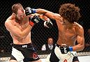 INGLEWOOD, CA - JUNE 04:  Cole Miller and Alex Caceres exchange blows in their featherweight bout during the UFC 199 event at The Forum on June 4, 2016 in Inglewood, California.  (Photo by Josh Hedges/Zuffa LLC/Zuffa LLC via Getty Images)