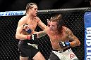 INGLEWOOD, CA - JUNE 04: Brian Ortega and Clay Guida exchange blows in their featherweight bout during the UFC 199 event at The Forum on June 4, 2016 in Inglewood, California.  (Photo by Harry How/Zuffa LLC/Zuffa LLC via Getty Images)