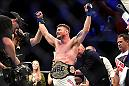 INGLEWOOD, CA - JUNE 04:  Michael Bisping of England celebrates after his first round knockout win against Luke Rockhold in their UFC middleweight championship bout during the UFC 199 event at The Forum on June 4, 2016 in Inglewood, California.  (Photo by Harry How/Zuffa LLC/Zuffa LLC via Getty Images)