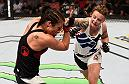 OTTAWA, ON - JUNE 18:   (R-L) Joanne Calderwood of Scotland punches Valerie Letourneau of Canada in their women's flyweight bout during the UFC Fight Night event inside the TD Place Arena on June 18, 2016 in Ottawa, Ontario, Canada. (Photo by Jeff Bottari/Zuffa LLC/Zuffa LLC via Getty Images)