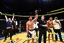 LAS VEGAS, NV - JULY 09: Gegard Mousasi of The Netherlands (center) reacts to his victory over Thiago Santos of Brazil (right) in their middleweight bout during the UFC 200 event on July 9, 2016 at T-Mobile Arena in Las Vegas, Nevada.  (Photo by Josh Hedges/Zuffa LLC/Zuffa LLC via Getty Images) *** Local Caption *** Gegard Mousasi; Thiago Santos