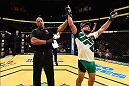 LAS VEGAS, NV - JULY 09: Kelvin Gastelum (right) reacts to his victory over Johny Hendricks in their welterweight bout during the UFC 200 event on July 9, 2016 at T-Mobile Arena in Las Vegas, Nevada.  (Photo by Josh Hedges/Zuffa LLC/Zuffa LLC via Getty Images) *** Local Caption *** Kelvin Gastelum
