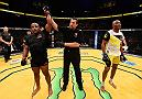 LAS VEGAS, NV - JULY 09: Daniel Cormier (left) reacts to his victory over Anderson Silva of Brazil (right) in their light heavyweight bout during the UFC 200 event on July 9, 2016 at T-Mobile Arena in Las Vegas, Nevada.  (Photo by Josh Hedges/Zuffa LLC/Zuffa LLC via Getty Images) *** Local Caption *** Daniel Cormier; Anderson Silva
