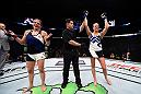 SIOUX FALLS, SD - JULY 13:   (R-L) Katlyn Chookagian celebrates her victory over Lauren Murphy in their women's bantamweight bout during the UFC Fight Night event on July 13, 2016 at Denny Sanford Premier Center in Sioux Falls, South Dakota. (Photo by Jeff Bottari/Zuffa LLC/Zuffa LLC via Getty Images)