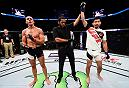 SIOUX FALLS, SD - JULY 13:   (R-L) Keita Nakamura celebrates his submission victory over Kyle Noke in their welterweight bout during the UFC Fight Night event on July 13, 2016 at Denny Sanford Premier Center in Sioux Falls, South Dakota. (Photo by Jeff Bottari/Zuffa LLC/Zuffa LLC via Getty Images)