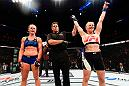 CHICAGO, IL - JULY 23:  (R-L) Valentina Shevchenko of Kyrgyzstan celebrates after defeating Holly Holm by unanimous decision in their women's bantamweight bout during the UFC Fight Night event at the United Center on July 23, 2016 in Chicago, Illinois. (Photo by Josh Hedges/Zuffa LLC/Zuffa LLC via Getty Images)
