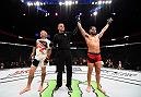 ATLANTA, GA - JULY 30:  (R-L) Jorge Masvidal celebrates his victory over Ross Pearson in their welterweight bout during the UFC 201 event on July 30, 2016 at Philips Arena in Atlanta, Georgia. (Photo by Jeff Bottari/Zuffa LLC/Zuffa LLC via Getty Images)
