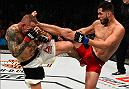 ATLANTA, GA - JULY 30:  (R-L) Jorge Masvidal kicks Ross Pearson in their welterweight bout during the UFC 201 event on July 30, 2016 at Philips Arena in Atlanta, Georgia. (Photo by Jeff Bottari/Zuffa LLC/Zuffa LLC via Getty Images)