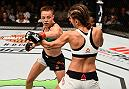 ATLANTA, GA - JULY 30:  (L-R) Rose Namajunas punches Karolina Kowalkiewicz in their women's strawweight bout during the UFC 201 event on July 30, 2016 at Philips Arena in Atlanta, Georgia. (Photo by Jeff Bottari/Zuffa LLC/Zuffa LLC via Getty Images)