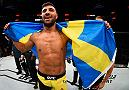 SALT LAKE CITY, UT - AUGUST 06:  David Teymur of Sweden celebrates his knockout victory over Jason Novelli in their lightweight bout during the UFC Fight Night event at Vivint Smart Home Arena on August 6, 2016 in Salt Lake City, Utah. (Photo by Jeff Bottari/Zuffa LLC/Zuffa LLC via Getty Images)