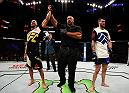 SALT LAKE CITY, UT - AUGUST 06:  (L-R) Thales Leites celebrates his submission victory over Chris Camozzi in their middleweight bout during the UFC Fight Night event at Vivint Smart Home Arena on August 6, 2016 in Salt Lake City, Utah. (Photo by Jeff Bottari/Zuffa LLC/Zuffa LLC via Getty Images)