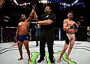 SALT LAKE CITY, UT - AUGUST 06:  (L-R) Dennis Bermudez celebrates his victory over Rony Jason of Brazil in their featherweight bout during the UFC Fight Night event at Vivint Smart Home Arena on August 6, 2016 in Salt Lake City, Utah. (Photo by Jeff Bottari/Zuffa LLC/Zuffa LLC via Getty Images)