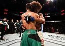SALT LAKE CITY, UT - AUGUST 06:  (L-R) Yair Rodriguez of Mexico and Alex Caceres hug after their featherweight bout during the UFC Fight Night event at Vivint Smart Home Arena on August 6, 2016 in Salt Lake City, Utah. (Photo by Jeff Bottari/Zuffa LLC/Zuffa LLC via Getty Images)