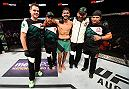 SALT LAKE CITY, UT - AUGUST 06:  Yair Rodriguez of Mexico poses for a picture with his team after defeating Alex Caceres in their featherweight bout during the UFC Fight Night event at Vivint Smart Home Arena on August 6, 2016 in Salt Lake City, Utah. (Photo by Jeff Bottari/Zuffa LLC/Zuffa LLC via Getty Images)