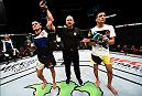 VANCOUVER, BC - AUGUST 27:  (L-R) Anthony Pettis of the United States celebrates his submission victory over Charles Oliveira of Brazil in their featherweight bout during the UFC Fight Night event at Rogers Arena on August 27, 2016 in Vancouver, British Columbia, Canada. (Photo by Jeff Bottari/Zuffa LLC/Zuffa LLC via Getty Images)