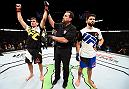 VANCOUVER, BC - AUGUST 27: (R-L) Demian Maia of Brazil celebrates his submission victory over Carlos Condit of the United States in their welterweight bout during the UFC Fight Night event at Rogers Arena on August 27, 2016 in Vancouver, British Columbia, Canada. (Photo by Jeff Bottari/Zuffa LLC/Zuffa LLC via Getty Images)