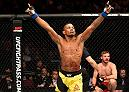 MANCHESTER, ENGLAND - OCTOBER 08:  (L-R) Iuri Alcantara of Brazil celebrates his submission victory over Brad Pickett of England in their bantamweight bout during the UFC 204 Fight Night at the Manchester Evening News Arena on October 8, 2016 in Manchester, England. (Photo by Josh Hedges/Zuffa LLC/Zuffa LLC via Getty Images)
