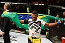 MANCHESTER, ENGLAND - OCTOBER 08:  Iuri Alcantara of Brazil celebrates his submission victory over Brad Pickett of England in their bantamweight bout during the UFC 204 Fight Night at the Manchester Evening News Arena on October 8, 2016 in Manchester, England. (Photo by Josh Hedges/Zuffa LLC/Zuffa LLC via Getty Images)