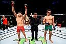 MEXICO CITY, MEXICO - NOVEMBER 05:  (L-R) Martin Bravo Flores of Mexico celebrates his victory over Claudio Puelles of Peru in their lightweight bout during the UFC Fight Night event at Arena Ciudad de Mexico on November 5, 2016 in Mexico City, Mexico. (Photo by Jeff Bottari/Zuffa LLC/Zuffa LLC via Getty Images)