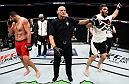 PHOENIX, AZ - JANUARY 15:  (R-L) Cyril Asker of France celebrates his victory over Dmitrii Smoliakov of Russia in their heavyweight bout during the UFC Fight Night event inside Talking Stick Resort Arena on January 15, 2017 in Phoenix, Arizona. (Photo by Jeff Bottari/Zuffa LLC/Zuffa LLC via Getty Images)