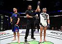 PHOENIX, AZ - JANUARY 15:  (R-L) Sergio Pettis celebrates his victory over John Moraga in their flyweight bout during the UFC Fight Night event inside Talking Stick Resort Arena on January 15, 2017 in Phoenix, Arizona. (Photo by Jeff Bottari/Zuffa LLC/Zuffa LLC via Getty Images)