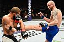 PHOENIX, AZ - JANUARY 15:  (R-L) Ben Saunders kicks Court McGee in their welterweight bout during the UFC Fight Night event inside Talking Stick Resort Arena on January 15, 2017 in Phoenix, Arizona. (Photo by Jeff Bottari/Zuffa LLC/Zuffa LLC via Getty Images)