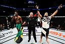 BROOKLYN, NEW YORK - FEBRUARY 11:  (L-R) Belal Muhammad celebrates his victory over Randy Brown of Jamaica in their welterweight bout during the UFC 208 event inside Barclays Center on February 11, 2017 in Brooklyn, New York. (Photo by Jeff Bottari/Zuffa LLC/Zuffa LLC via Getty Images)