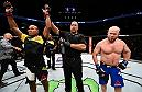 BROOKLYN, NEW YORK - FEBRUARY 11:  (L-R) Ronaldo Souza of Brazil celebrates his submission victory over Tim Boetsch in their middleweight bout during the UFC 208 event inside Barclays Center on February 11, 2017 in Brooklyn, New York. (Photo by Jeff Bottari/Zuffa LLC/Zuffa LLC via Getty Images)