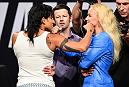 DALLAS, TX - MAY 12:  (L-R) UFC women's bantamweight champion Amanda Nunes of Brazil and Valentina Shevchenko of Kyrgyzstan face off during the UFC Summer Kickoff Press Conference at the American Airlines Center on May 12, 2017 in Dallas, Texas. (Photo by Josh Hedges/Zuffa LLC/Zuffa LLC via Getty Images)
