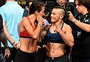DALLAS, TX - MAY 12:  (L-R) UFC women's strawweight champion Joanna Jedrzejczyk of Poland and Jessica Andrade of Brazil face off during the UFC 211 weigh-in at the American Airlines Center on May 12, 2017 in Dallas, Texas. (Photo by Josh Hedges/Zuffa LLC/Zuffa LLC via Getty Images)