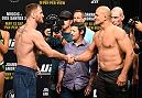 DALLAS, TX - MAY 12:  (L-R) UFC heavyweight champion Stipe Miocic and Junior Dos Santos of Brazil shake hands during the UFC 211 weigh-in at the American Airlines Center on May 12, 2017 in Dallas, Texas. (Photo by Josh Hedges/Zuffa LLC/Zuffa LLC via Getty Images)