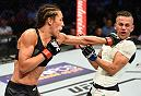 DALLAS, TX - MAY 13:  (L-R) Joanna Jedrzejczyk punches Jessica Andrade in their UFC women's strawweight championship fight during the UFC 211 event at the American Airlines Center on May 13, 2017 in Dallas, Texas. (Photo by Josh Hedges/Zuffa LLC/Zuffa LLC via Getty Images)