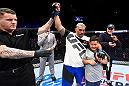 AUCKLAND, NEW ZEALAND - JUNE 11:  Mark Hunt of New Zealand celebrates with his family after defeating Derrick Lewis in their heavyweight fight during the UFC Fight Night event at the Spark Arena on June 11, 2017 in Auckland, New Zealand. (Photo by Josh Hedges/Zuffa LLC/Zuffa LLC via Getty Images)