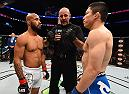 MONTREAL, QC - APRIL 25:   (L-R) Opponents Demetrious Johnson of the United States and Kyoji Horiguchi of Japan face off before their UFC flyweight championship bout during the UFC 186 event at the Bell Centre on April 25, 2015 in Montreal, Quebec, Canada. (Photo by Josh Hedges/Zuffa LLC/Zuffa LLC via Getty Images)