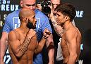 LAS VEGAS, NV - APRIL 20:   (L-R) Opponents Demetrious Johnson and Henry Cejudo face off during the UFC 197 weigh-in at the MGM Grand Garden Arena on April 20, 2016 in Las Vegas, Nevada. (Photo by Josh Hedges/Zuffa LLC/Zuffa LLC via Getty Images)