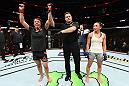 CHICAGO, ILLINOIS - JUNE 09:  (L-R) Claudia Gadelha of Brazil reacts after defeating Carla Esparza in their women's strawweight fight during the UFC 225 event at the United Center on June 9, 2018 in Chicago, Illinois. (Photo by Josh Hedges/Zuffa LLC/Zuffa LLC via Getty Images)