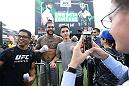 SINGAPORE - JUNE 20:  Tyson Pedro (C) of Australia poses for a photo with fans during the UFC Fight Night Open Workout at OCBC Square on June 20, 2018 in Singapore.  (Photo by Suhaimi Abdullah - Zuffa LLC/Zuffa LLC)