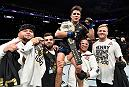 LOS ANGELES, CA - AUGUST 04:  Henry Cejudo celebrates after his split-decision victory over Demetrious Johnson in their UFC flyweight championship fight during the UFC 227 event inside Staples Center on August 4, 2018 in Los Angeles, California. (Photo by Jeff Bottari/Zuffa LLC/Zuffa LLC via Getty Images)