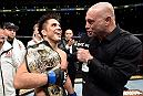 LOS ANGELES, CA - AUGUST 04:  Henry Cejudo is interviewed by Joe Rogan after his split-decision victory over Demetrious Johnson in their UFC flyweight championship fight during the UFC 227 event inside Staples Center on August 4, 2018 in Los Angeles, California. (Photo by Jeff Bottari/Zuffa LLC/Zuffa LLC via Getty Images)