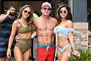 A fan poses poolside with ring girls Birttney Palmer and Arianny Celeste during UFC's International Fight Week in Las Vegas, NV.