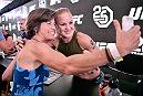 LAS VEGAS, NEVADA - JULY 07: UFC women's flyweight fighter Valentina Shevchenko of Kyrgyzstan  poses for a photo with a fan during the UFC Fan Experience at the Downtown Las Vegas Events Center on July 7, 2018 in Las Vegas, Nevada. (Photo by Brandon Magnus/Zuffa LLC/Zuffa LLC via Getty Images)