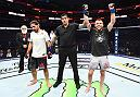 DALLAS, TX - SEPTEMBER 08:  (R-L) Jarred Brooks celebrates his victory over Roberto Sanchez in their flyweight fight during the UFC 228 event at American Airlines Center on September 8, 2018 in Dallas, Texas. (Photo by Josh Hedges/Zuffa LLC/Zuffa LLC via Getty Images)