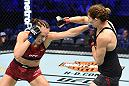 DALLAS, TX - SEPTEMBER 08:  (L-R) Lucie Pudilova of Czech Republic punches Irene Aldana of Mexico in their women's bantamweight fight during the UFC 228 event at American Airlines Center on September 8, 2018 in Dallas, Texas. (Photo by Josh Hedges/Zuffa LLC/Zuffa LLC via Getty Images)