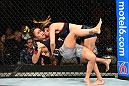 DALLAS, TX - SEPTEMBER 08:  (R-L) Tatiana Suarez takes down Carla Esparza in their women's strawweight fight during the UFC 228 event at American Airlines Center on September 8, 2018 in Dallas, Texas. (Photo by Josh Hedges/Zuffa LLC/Zuffa LLC via Getty Images)