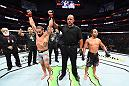 DALLAS, TX - SEPTEMBER 08:  (L-R) Jimmie Rivera celebrates after defeating John Dodson by unanimous decision in their bantamweight fight during the UFC 228 event at American Airlines Center on September 8, 2018 in Dallas, Texas. (Photo by Josh Hedges/Zuffa LLC/Zuffa LLC via Getty Images)